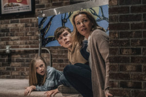 (from left) Sammy Mansell (Paisley Cadorath), Brady Mansell (Gage Munroe) and Becca Mansell (Connie Nielsen) in Nobody, directed by Ilya Naishuller.